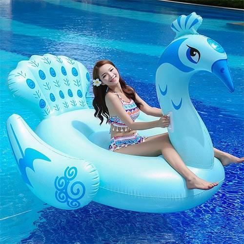 Femme sur bouée XL paon bleu